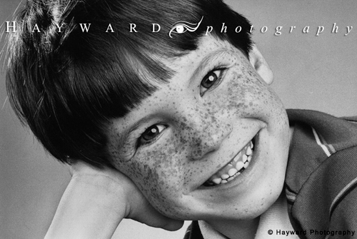 Freckled Boy\'s Smiling Head Shot