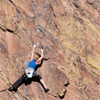 Female Climber Stretches into Her Next Move, 401106B_007