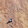 Female Climber Stretches into Her Next Move, 401106B_ 008