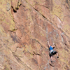 Female Climber Stretches into Her Next Move, 401106B_025