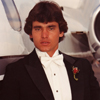 Male Model in Tuxedo next to a Lear Jet