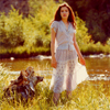 Female Model in Light Summer Dress Next to River