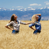 Two Female Models Posing in Wheat Field