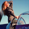 Female Model In Very Early Sunlight on a WWII P51 Mustang Fighter
