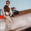 Male Model In Very Early Sunlight on a WWII P51 Mustang Fighter