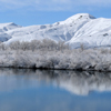 Snow Blankets an Owl Creek Mountain Reflected in Big Horn River 52_3VP